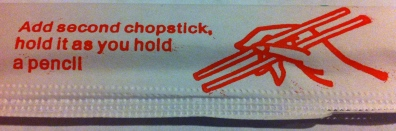 """Add second chopstick, hold it as you hold a pencil."""