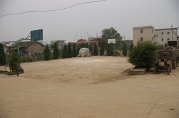A CR-era basketball court in the middle of a village.