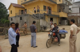 Asking local villagers where *the* Gao Village.